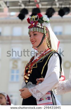ZAGREB, CROATIA - JULY 17: Members of folk group Kitka from Istibanja, Macedonia during the 49th International Folklore Festival in center of Zagreb, Croatia on July 17, 2015 - stock photo