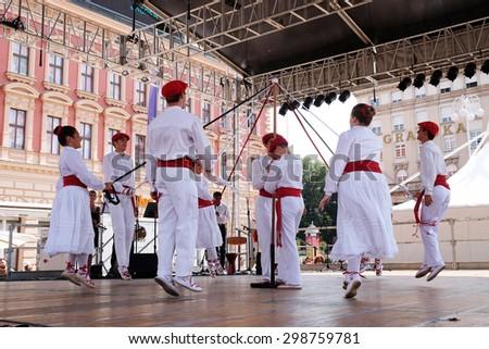 ZAGREB, CROATIA - JULY 16: Members of folk group Lagunekin from Bardos, France during the 48th International Folklore Festival in center of Zagreb, Croatia on July 16, 2015 - stock photo