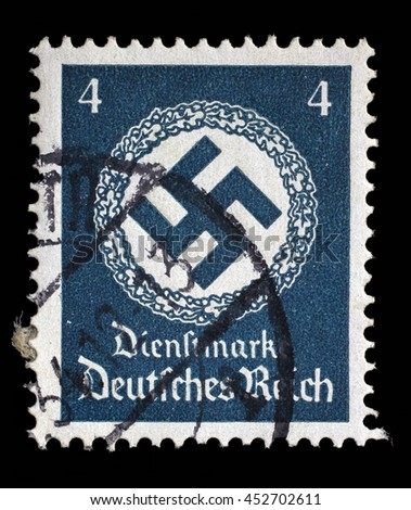 ZAGREB, CROATIA - JUNE 22: A postage stamp printed in Germany shows the Swastika in an oak wreath, circa 1942, on June 22, 2014, Zagreb, Croatia - stock photo