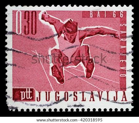 ZAGREB, CROATIA - JUNE 14: A stamp printed by Yugoslavia shows Long jump, Balkan Games in Sarajevo, circa 1966, on June 14, 2014, Zagreb, Croatia - stock photo