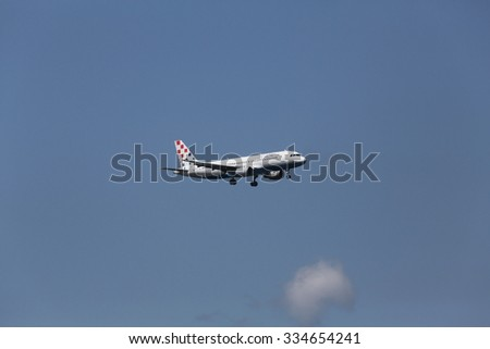 ZAGREB, CROATIA - JUNE 10: Airbus A320, registration 9A-CTK of Croatia Airlines landing on Zagreb Airport Pleso on June 10, 2015. - stock photo