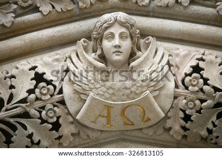 ZAGREB, CROATIA - JUNE 04: Angel on the portal of the cathedral dedicated to the Assumption of Mary and to kings Saint Stephen and Saint Ladislaus in Zagreb on June 04, 2011. - stock photo