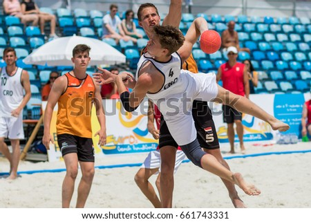 ZAGREB, CROATIA - JUNE 17, 2017: Beach Handball Euro 2017 U-17 Netherlands vs. Croatia. Player is flying through air and shooting at the goal.