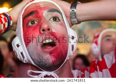 ZAGREB, CROATIA - JUNE 12, 2014: Croatian football fan wearing water polo cap at Ban Josip Jelacic square support national team during the world cup match between Croatia and Brazil.