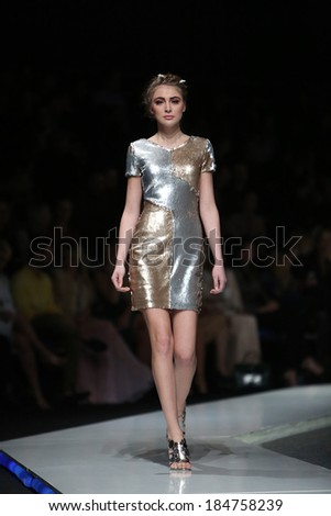 ZAGREB, CROATIA - MARCH 27: Fashion model wearing clothes designed by Martina Felja on the 'Fashion.hr' show on March 27, 2014 in Zagreb, Croatia.