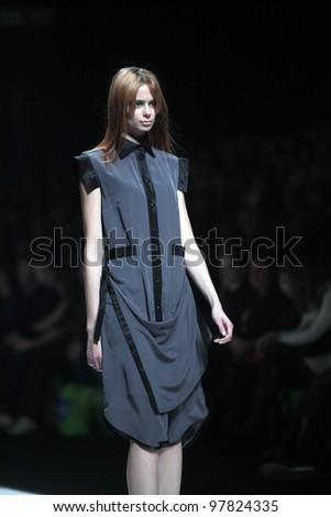 "ZAGREB, CROATIA - MARCH 16: Fashion model wears clothes made by Ana Maria Ricov on ""Dove FASHION.HR"" show on March 16, 2012 in Zagreb, Croatia. - stock photo"