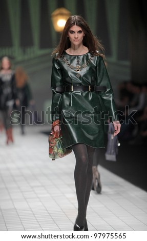 "ZAGREB, CROATIA - MARCH 17: Fashion model wears clothes made by Hera by Robert Sever on ""Dove FASHION.HR"" show on March 17, 2012 in Zagreb, Croatia. - stock photo"