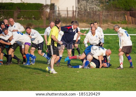 ZAGREB, CROATIA - MARCH 29, 2014: Friendly rugby match RC Zagreb Old Lions in white jersey (CRO) and Reigate RFC in blue jersey (UK). Unidentified players on field.