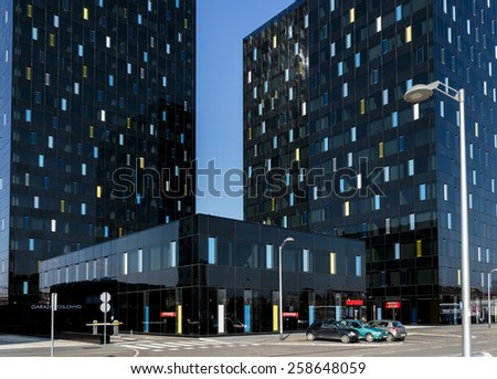ZAGREB, CROATIA - MARCH 07, 2015: New metal and black glass business buildings in downtown of Zagreb with Konzum grocery store in the middle. - stock photo