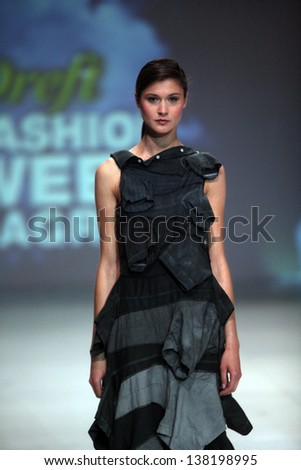 "ZAGREB, CROATIA - May 11: Fashion model wears clothes made by Ana Kujundzic on ""ZAGREB DREFT FASHION WEEK"" show on May 11, 2013 in Zagreb, Croatia."