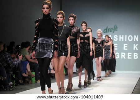 """ZAGREB, CROATIA - MAY 11: Fashion model wears clothes made by Ivancica Hrustic on """"ZAGREB FASHION WEEK"""" show on May 11, 2012 in Zagreb, Croatia. - stock photo"""