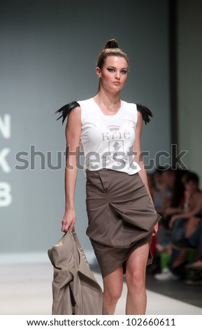 "ZAGREB, CROATIA - MAY 10: Fashion model wears clothes made by Kristina Burja on ""ZAGREB FASHION WEEK"" show on May 10, 2012 in Zagreb, Croatia."