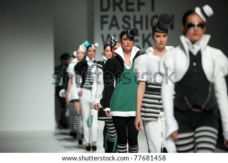 ZAGREB, CROATIA - MAY 19: Fashion models wear clothes made by Aba Tomicic in 'Fashion Week' show on May 19, 2011 in Zagreb, Croatia. - stock photo