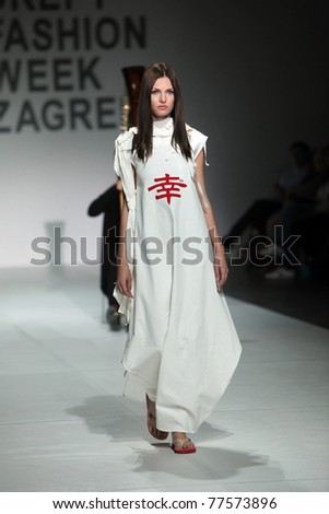 ZAGREB, CROATIA - MAY 19: Fashion models wear clothes made by Sanja Jakupec in 'Fashion Week' show on May 19, 2011 in Zagreb, Croatia. - stock photo