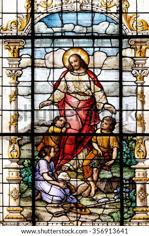 ZAGREB, CROATIA - MAY 28: Jesus friend of the children, stained glass window in the Basilica of the Sacred Heart of Jesus in Zagreb, Croatia on May 28, 2015