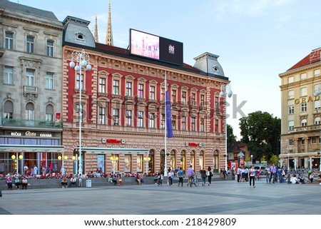 ZAGREB, CROATIA -May 21, 2014 - People walk along Ban Jelacic Square, the central square of the city Zagreb, Croatia.Many tourists visit Ban Jelacic square, which is located in old city core. - stock photo