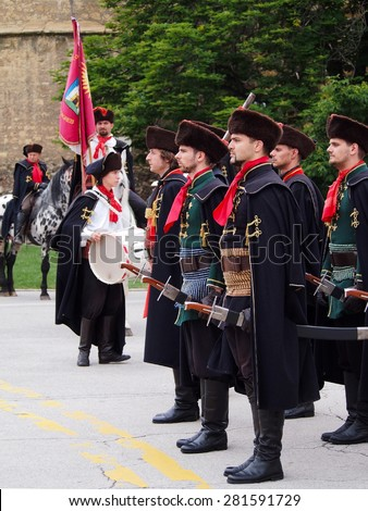 ZAGREB, CROATIA - MAY 24, 2015: The Cravat Regiment is a guard of honour and tourist attraction. Since 2010 the regiment is performing a march in the Upper Town of Zagreb, Croatia.