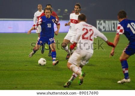 ZAGREB, CROATIA - NOV 15: Luka Modric (10) in action -  Croatia vs. Turkey, second leg of the UEFA EURO 2012 play-offs at the Maksimir stadium on November 15, 2011 Zagreb, Croatia. - stock photo