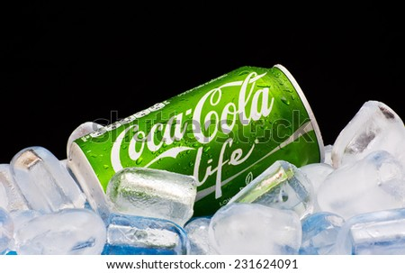 ZAGREB , CROATIA - NOVEMBER 19 ,2014 :   Coca-Cola Life can splashed with water on ice cubes in black background, product shot - stock photo