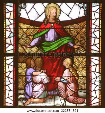 ZAGREB, CROATIA - NOVEMBER 08: Jesus friend of children stained glass window in the Church of St. Vincent de Paul in Zagreb, Croatia on November 08, 2014 - stock photo