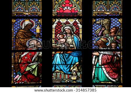 ZAGREB, CROATIA - NOVEMBER 21: Nativity Scene, Adoration of the Magi, stained glass window in parish church of Saint Mark in Zagreb, Croatia on November 21, 2014 - stock photo