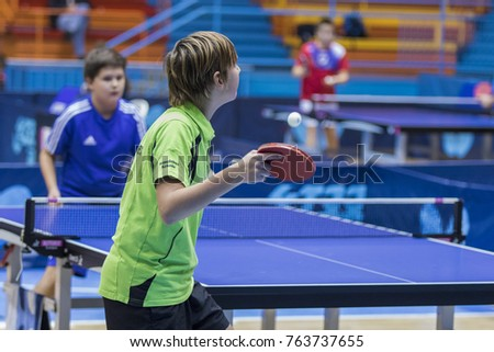 ZAGREB, CROATIA - NOVEMBER 25, 2017: Table tennis international memorial  Antun Tova Stipancic. Kid player serves the ball