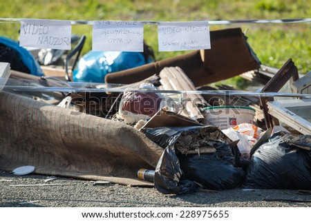 ZAGREB, CROATIA - NOVEMBER 2, 2014: Unauthorised garbage dump in the middle of the street at resident area.