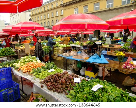 ZAGREB, CROATIA - NOVEMBER 8: Unidentified people shop for fruits and vegetables at Dolac Market on November 8, 2010 in Zagreb, Croatia. Dolac is the largest farmer's market in Zagreb.