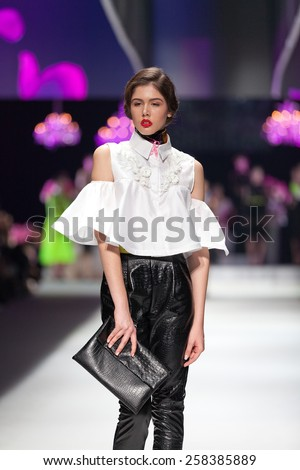 ZAGREB, CROATIA - OCTOBER 18, 2014: Fashion model wearing clothes designed by Envy Room on the 'Fashion.hr' fashion show  - stock photo