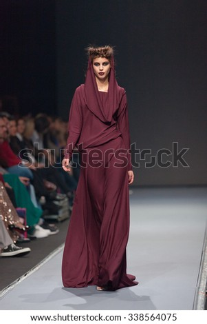 ZAGREB, CROATIA - OCTOBER 31, 2015: Fashion model wearing clothes designed by Ivica Skoko on the 'Fashion.hr' fashion show - stock photo