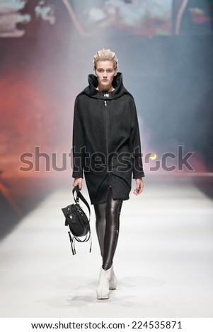 ZAGREB, CROATIA - OCTOBER 18, 2014: Fashion model wearing clothes designed by Marina Design and Marija Ivanovic bag on the 'Fashion.hr' fashion show - stock photo