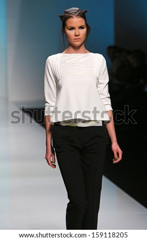 ZAGREB, CROATIA - OCTOBER 17: Fashion model wearing clothes designed by Marina Design on the 'Fashion.hr' show on October 17, 2013 in Zagreb, Croatia.