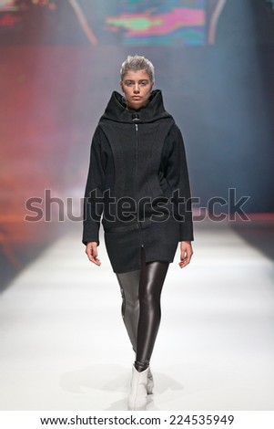 ZAGREB, CROATIA - OCTOBER 18,2014: Fashion model wearing clothes designed by Marina Design on the 'Fashion.hr' fashion show  - stock photo