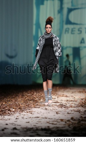 ZAGREB, CROATIA - OCTOBER 25: Fashion model wearing clothes designed by XD Xenia Design on the Cro a Porter show on October 25, 2013 in Zagreb, Croatia.
