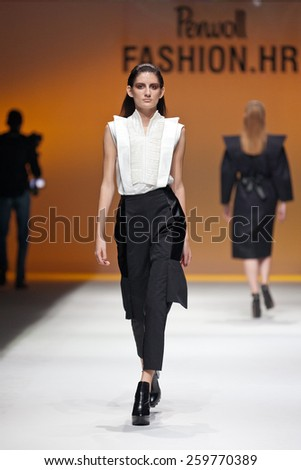 ZAGREB, CROATIA - OCTOBER 18, 2014: Fashion model wearing designer clothes on the 'Fashion.hr' fashion show  - stock photo
