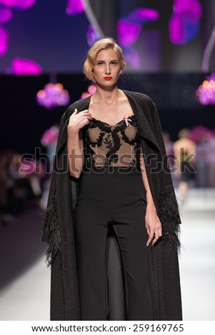 ZAGREB, CROATIA - OCTOBER 18, 2014: Fashion model wears clothes designed by Envy Room on the 'Fashion.hr' fashion show  - stock photo