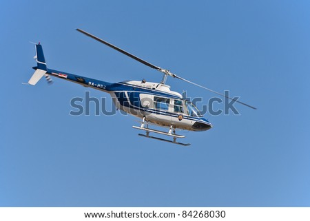 ZAGREB, CROATIA - SEP 3: Police helicopter Bell 206 performing during 11th Zagreb Air Show 2011 on Sep 3, 2011 in Zagreb, Croatia.