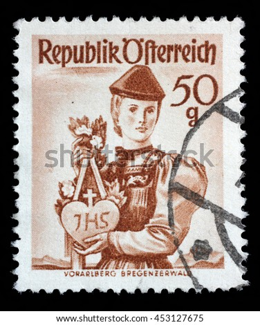 "ZAGREB, CROATIA - SEPTEMBER 13: A stamp printed in Austria from the ""Provincial Costumes"" issue shows a woman from Vorarlberg Bregenzerwald, circa 1948, on September 13, 2014, Zagreb, Croatia - stock photo"