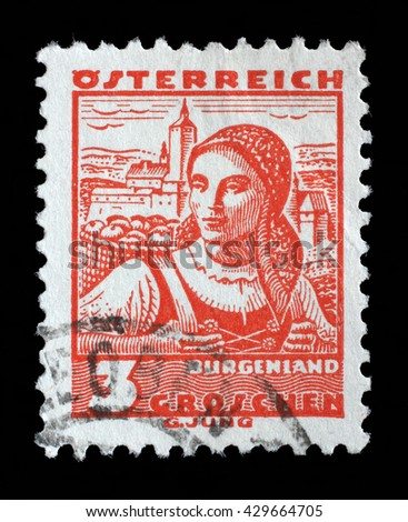"""ZAGREB, CROATIA - SEPTEMBER 13: A stamp printed in Austria shows a woman in the Austrian national dress with the inscription """"Burgenland"""" circa 1934, on September 13, 2014, Zagreb, Croatia - stock photo"""