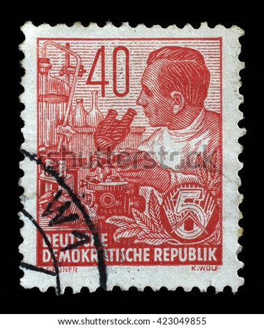 ZAGREB, CROATIA - SEPTEMBER 05: A stamp printed in GDR shows a Chemist, chemical plant, from the series Workers For The Five-year Plan, circa 1953, on September 05, 2014, Zagreb, Croatia - stock photo
