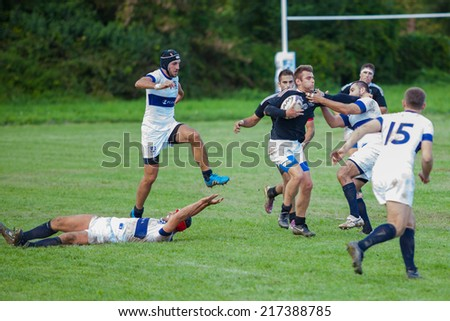 ZAGREB, CROATIA - SEPTEMBER 13, 2014: Croatian Rugby league - RC Zagreb Old Lions (white jersey) VS RC Sinj (dark blue jersey). Unidentified players on field.