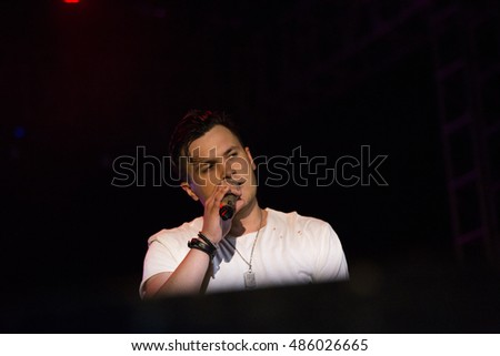 ZAGREB, CROATIA - SEPTEMBER 17, 2016: Domagoj Pisuljak frontman of OSDS band during opening act of Opca opasnost rock band concert on Salata stadium in Zagreb
