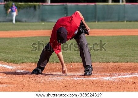 ZAGREB, CROATIA - SEPTEMBER 6, 2015: Match between Baseball Club Zagreb and Nada. Umpire is cleaning home base