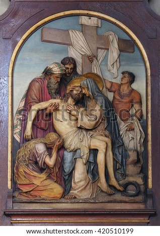 ZAGREB, CROATIA - SEPTEMBER 14: 13th Stations of the Cross,Jesus' body is removed from the cross, Basilica of the Sacred Heart of Jesus in Zagreb, Croatia on September 14, 2015 - stock photo