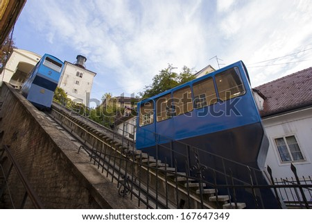 Zagreb funicular. One of Zagreb's landmarks. Two cable cars running simultaneously. Tower of Lotrscak is on the upper side of the small incline.
