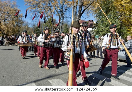 "ZAKARPATTYA, UKRAINE - OCTOBER 21: Unidentified local men carry traditional alpine musical horns ""trembita"" ; in the annual music festival, October 21, 2012 in Yasinya, Zakarpattya, Ukraine."