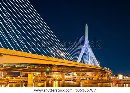 Zakim Bunker Hill bridge in Boston, MA by night - stock photo