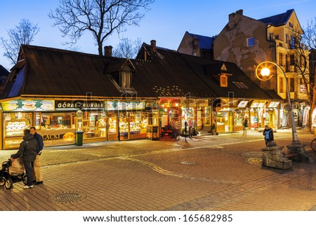 ZAKOPANE - NOVEMBER 17: Shops along the Krupowki street, the main shopping area and pedestrian promenade in the city center  in Zakopane in Poland on November 17, 2013