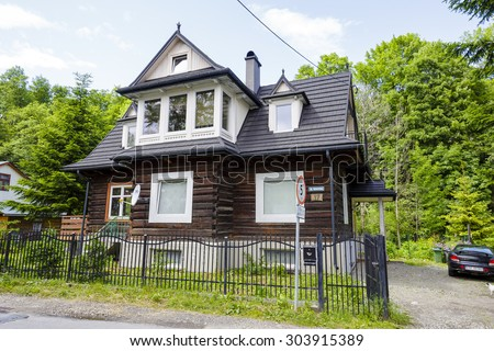 ZAKOPANE, POLAND - JUNE 21, 2015: Made of wooden logs the residential house, built approx. 1930, listed in the municipal records of historic architecture - stock photo