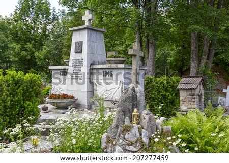 ZAKOPANE, POLAND - JUNE 23, 2014: Monument to the World War II Victims in the New Cemetery, erected in 1962, Here lie the victims of executions done by Nazi in the city during the World War II